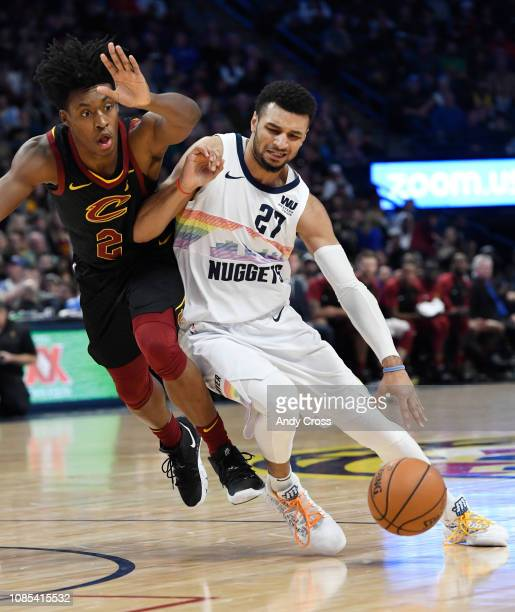 Denver Nuggets guard Jamal Murray gets fouled by Cleveland Cavaliers guard Collin Sexton in the second half at the Pepsi Center January 19 2019