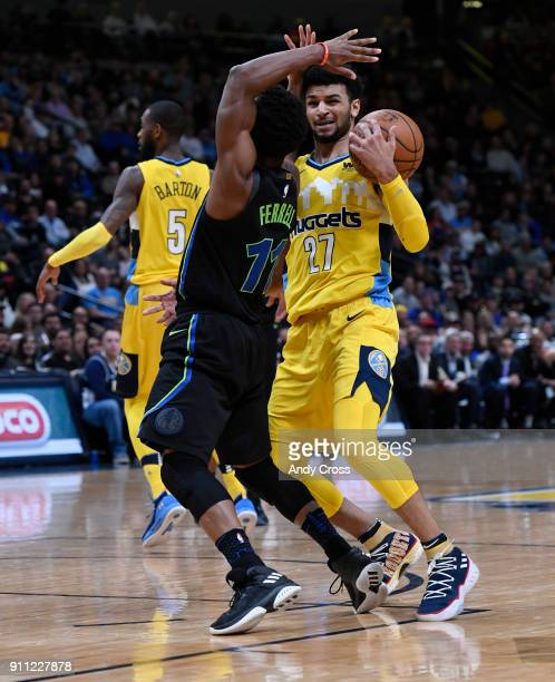 Denver Nuggets guard Jamal Murray grabs rebound from Dallas Mavericks guard Yogi Ferrell at the Pepsi Center January 27 2018