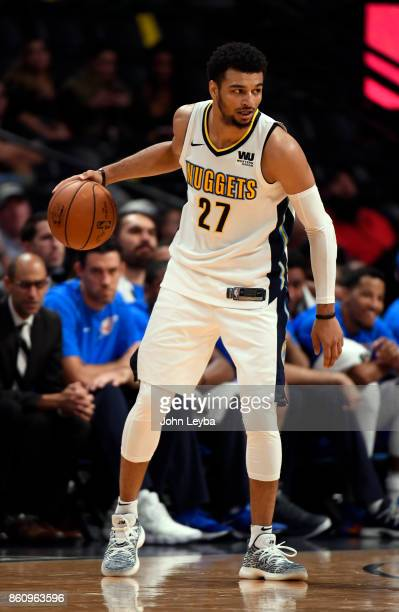 Denver Nuggets guard Jamal Murray looks to pass during their game against the Oklahoma City Thunder on October 10 2017 in Denver Colorado at Pepsi...
