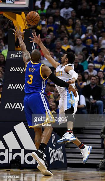 Denver Nuggets guard Jamal Murray scoops up a shot past Golden State Warriors forward David West during the fourth quarter November 10 2016 at Pepsi...