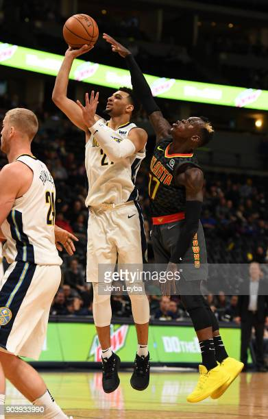 Denver Nuggets guard Jamal Murray takes a shot as Atlanta Hawks guard Dennis Schroder attempts to block it during the fourth quarter on January 10...
