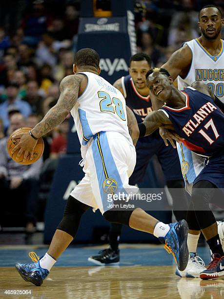 Denver Nuggets guard Jameer Nelson drives around a Atlanta Hawks guard Dennis Schroder as he gets caught in a pick during the second quarter March 11...