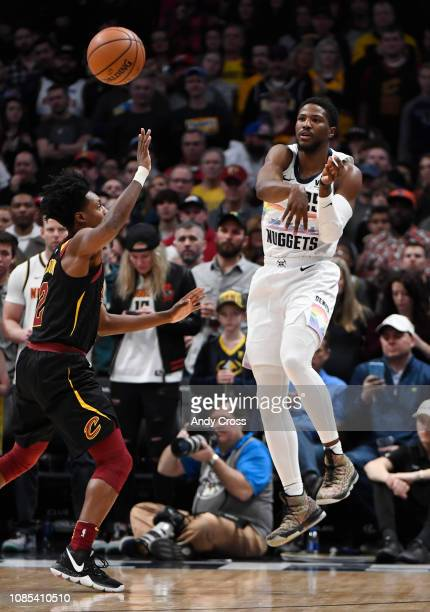 Denver Nuggets guard Malik Beasley passes agains the defense of Cleveland Cavaliers guard Collin Sexton in the first quarter at the Pepsi Center...