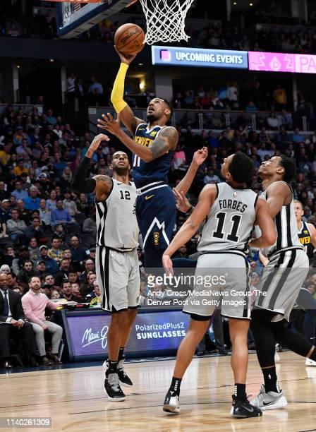 Denver Nuggets guard Monte Morris shoots over San Antonio Spurs center LaMarcus Aldridge in the second half at the Pepsi Center April 03 2019