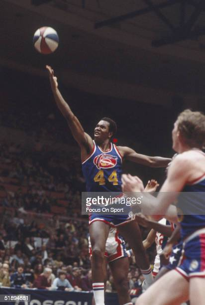 Denver Nuggets guard Ralph Sampson jumps to shoot against the New York Nets with the American Basketball Association