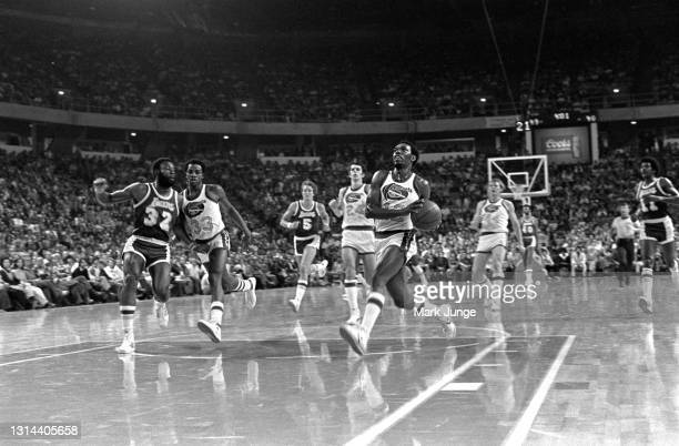 Denver Nuggets guard Ted McClain races downcourt for a layup against the Los Angeles Lakers during an NBA game at McNichols Arena on November 24,...