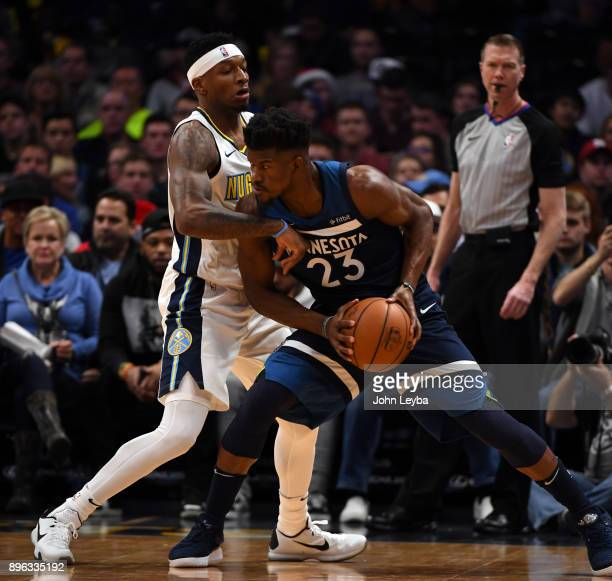 Denver Nuggets guard Torrey Craig guards Minnesota Timberwolves guard Jimmy Butler during the first quarter on December 20 2017 in Denver Colorado at...