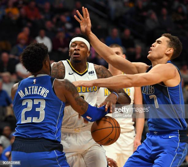 Denver Nuggets guard Torrey Craig loses control of the ball between Dallas Mavericks guard Wesley Matthews and forward Dwight Powell during the first...