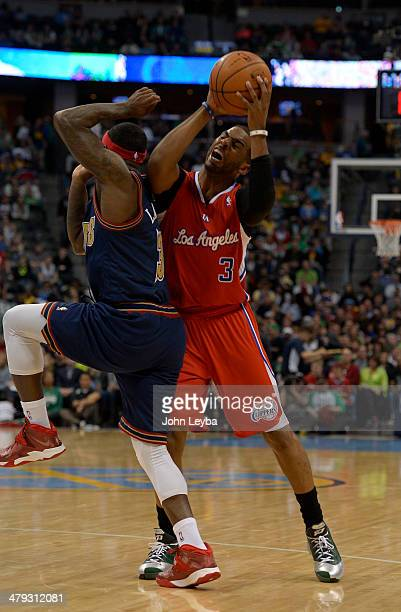 Denver Nuggets guard Ty Lawson commits a foul as he runs in to Los Angeles Clippers guard Chris Paul during the third quarter March 17 2014 at Pepsi...