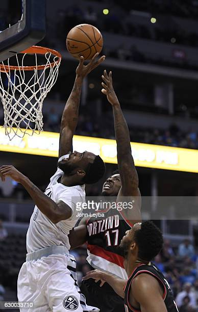 Denver Nuggets guard Will Barton blocks a shot by Portland Trail Blazers forward Ed Davis during the fourth quarter December 15 2016 at Pepsi Center