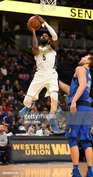 Denver Nuggets guard Will Barton drives to the basket as Dallas Mavericks forward Dirk Nowitzki looks on during the first quarter mon January 16 2018...