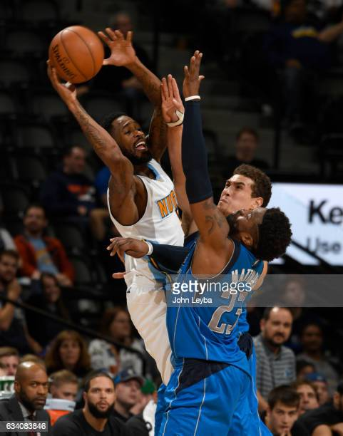Denver Nuggets guard Will Barton gets double teamed by Dallas Mavericks guard Wesley Matthews and Dallas Mavericks forward Dwight Powell during the...
