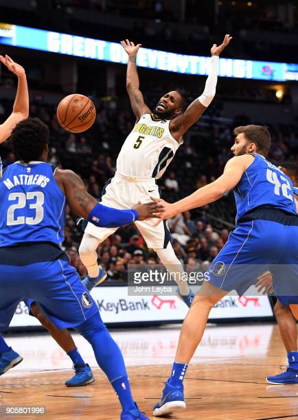 Denver Nuggets guard Will Barton gets the ball knocked away as Dallas Mavericks guard Wesley Matthews and forward Maximilian Kleber watch for the...