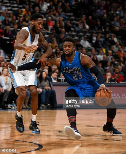 Denver Nuggets guard Will Barton grabs ahold of Dallas Mavericks guard Wesley Matthews as attempt to drive past him during the third quarter February...