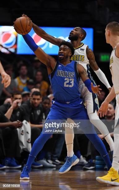 Denver Nuggets guard Will Barton knocks the ball away from Dallas Mavericks guard Wesley Matthews during the first quarter on January 16 2018 at...