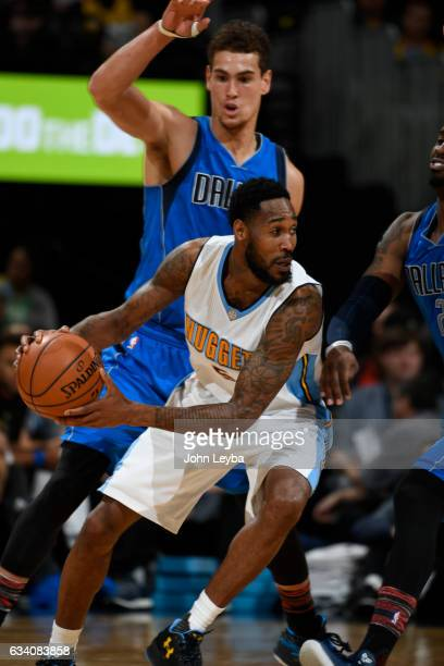 Denver Nuggets guard Will Barton looks to pass as he is covered by Dallas Mavericks forward Dwight Powell during the fourth quarter February 6 2017...