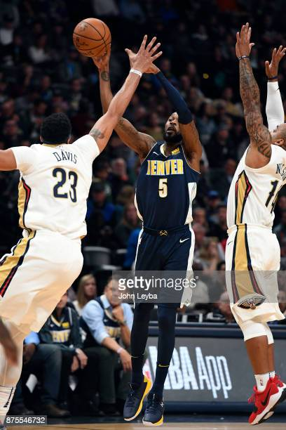 Denver Nuggets guard Will Barton makes a pass over New Orleans Pelicans forward Anthony Davis during the first quarter on November 17 2017 in Denver...