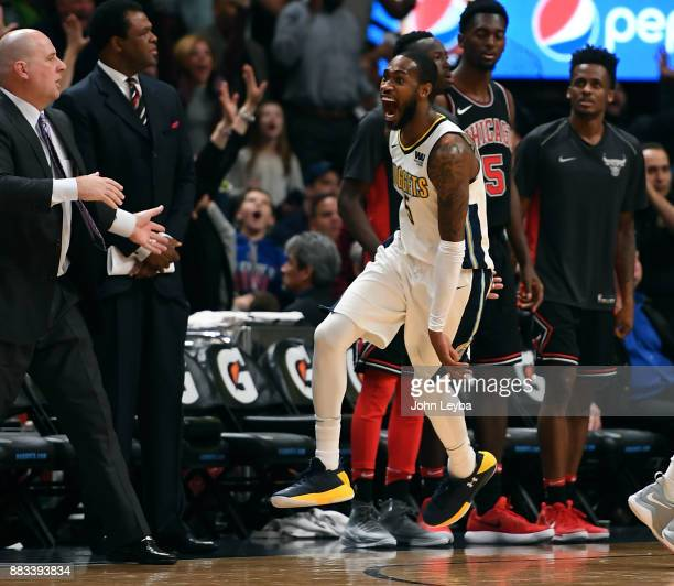 Denver Nuggets guard Will Barton screams out in jubilation in front of the Chicago Bulls bench after scoring the winning basket to defeat the Bulls...