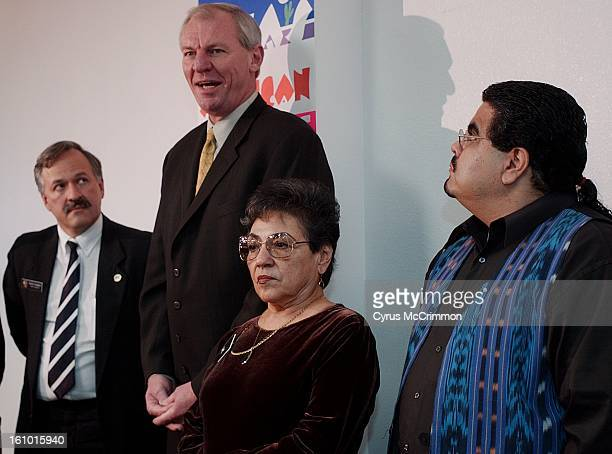 Denver Nuggets head basketball coach Dan Issel talks at a press conference after a luncheon with the Hispanic community on Wednesday December 19,...