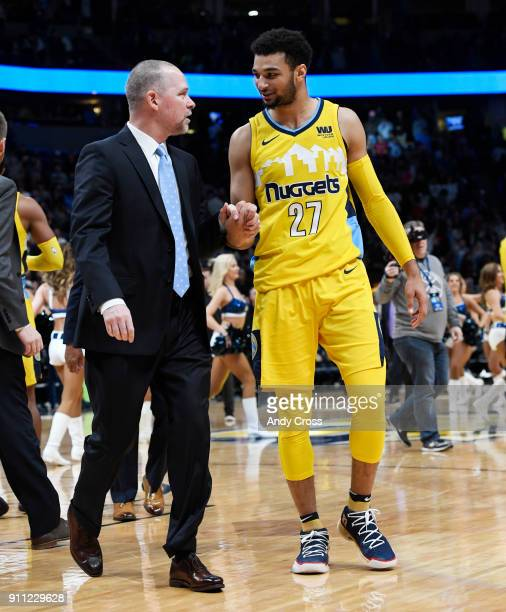 Denver Nuggets head coach Mike Malone congratulates Denver Nuggets guard Jamal Murray after defeating the Dallas Mavericks 9189 at the Pepsi Center...