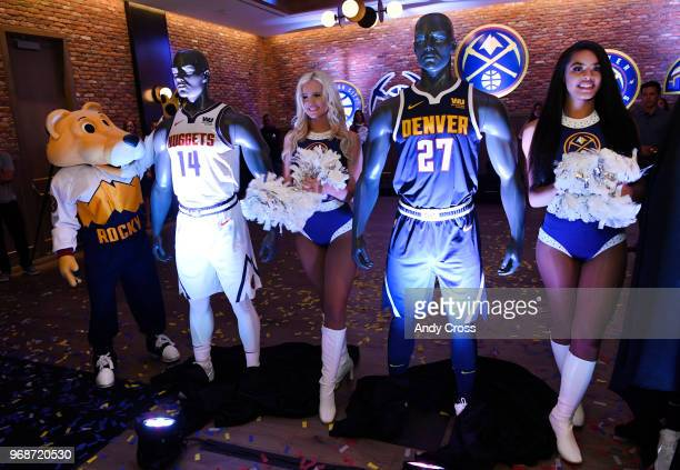 Denver Nuggets mascot Rocky left and Nuggets dancers Ashley center and Hannah right unveil the Denver Nuggets new uniforms and logos at the Evolve...