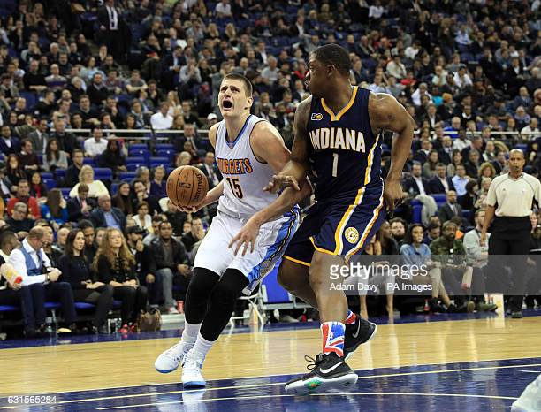 Denver Nuggets Nikola Jokic and Indiana Pacers Kevin Seraphin during the NBA Global game at the O2 Arena London