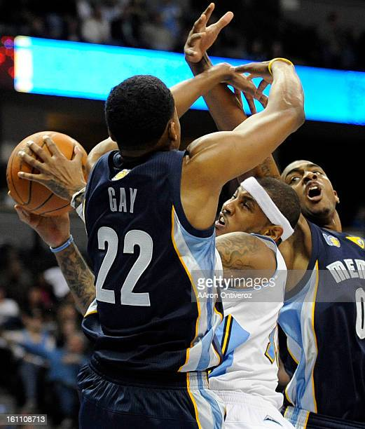 Denver Nuggets player Carmelo Anthony drives as he is defended Memphis Grizzlies players Rudy Gay and Darrell Arthur on December 5 2010 at the Pepsi...