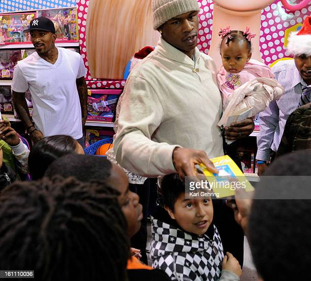 Denver Nuggets players JR Smith left and Al Harrington at right with his daughter Amaya age 1 donated funds so that kids who participate in The...
