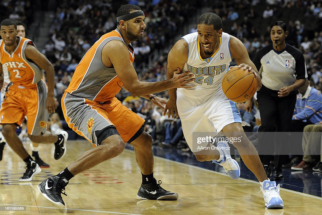 Denver Nuggets point guard Andre Miller (24) drives on Phoenix Suns small forward Jared Dudley (3) at the Pepsi Center on Tuesday, December 20, 2011. AAron Ontiveroz, The Denver Post : News Photo