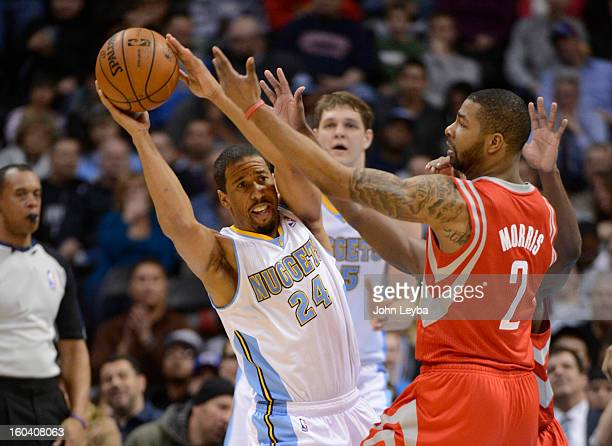 Denver Nuggets point guard Andre Miller is forced by Houston Rockets power forward Marcus Morris to make a pass by during the third quarter January...