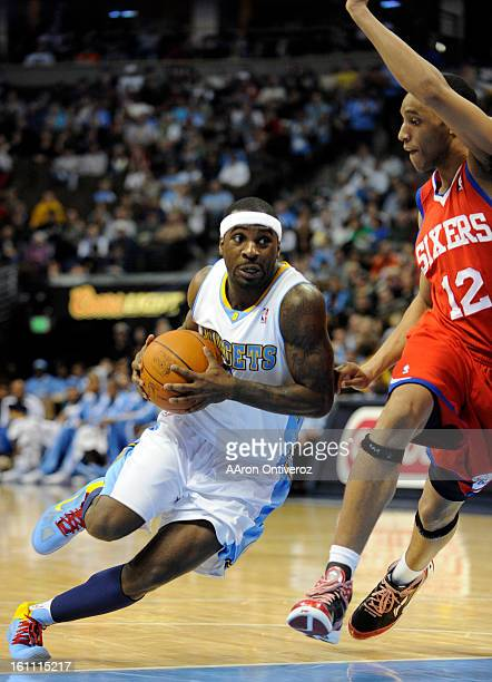 Denver Nuggets point guard Ty Lawson drives against Philadelphia 76ers shooting guard Evan Turner during the third quarter of Denver's 9589 loss on...