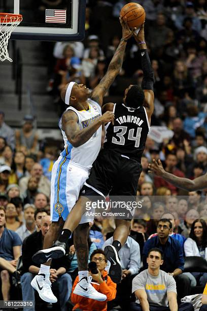 Denver Nuggets power forward Al Harrington blocks a shot by Sacramento Kings center Jason Thompson during the second half of the Nuggets' 119116 win...