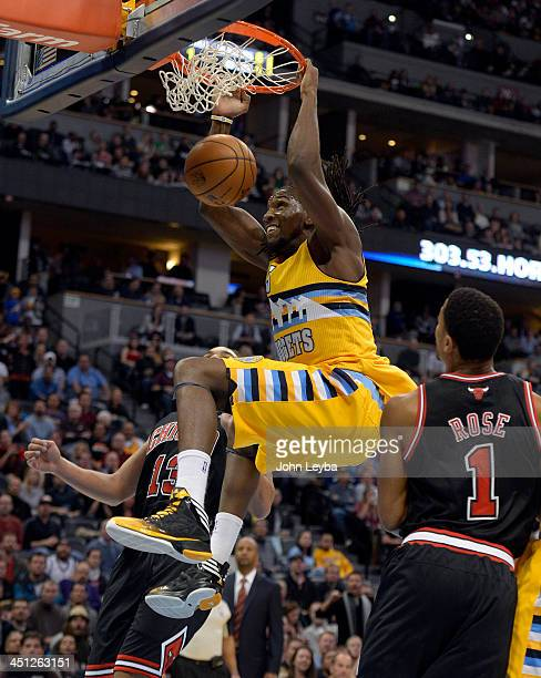 Denver Nuggets power forward Kenneth Faried gets a monster dunk as Chicago Bulls point guard Derrick Rose looks on during the first quarter November...