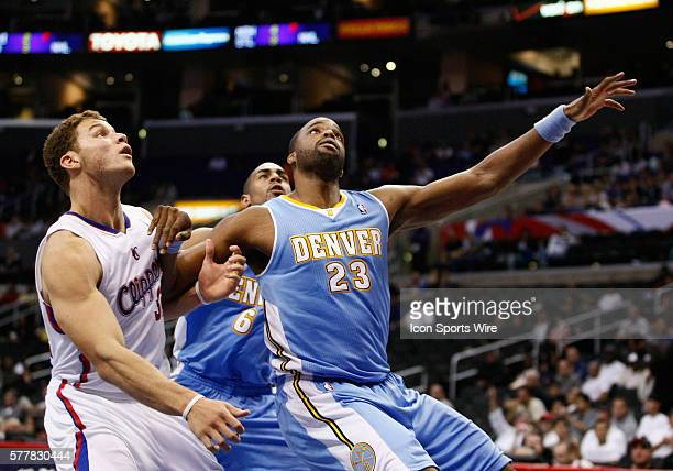Denver Nuggets power forward Shelden Williams and Los Angeles Clippers power forward Blake Griffin battle for position as the Los Angeles Clippers...