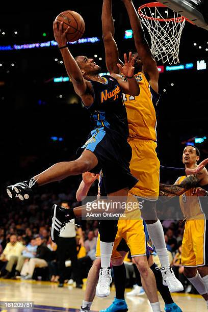 Denver Nuggets shooting guard Arron Afflalo drives on Los Angeles Lakers center Andrew Bynum during the second half of game five in their NBA playoff...