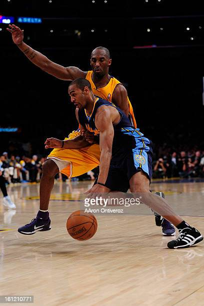 Denver Nuggets shooting guard Arron Afflalo drives on Los Angeles Lakers shooting guard Kobe Bryant during the first half of game two of their...