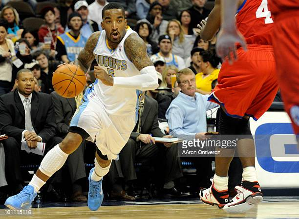 Denver Nuggets shooting guard JR Smith drives against the Philadelphia 76ers during the first quarter on Sunday December 26 2010 at the Pepsi Center...