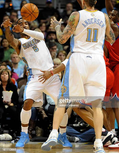 Denver Nuggets shooting guard JR Smith kicks a pass out to Chris Andersen against the Philadelphia 76ers during the second quarter on Sunday December...