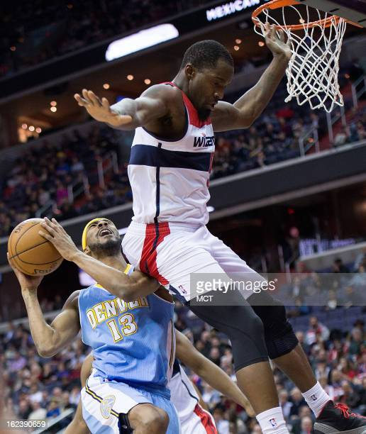 Denver Nuggets small forward Corey Brewer is fouled by Washington Wizards small forward Martell Webster during the first half of their game played at...