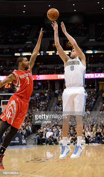 Denver Nuggets small forward Danilo Gallinari shoots a three point shot over Houston Rockets power forward Marcus Morris during the second quarter...