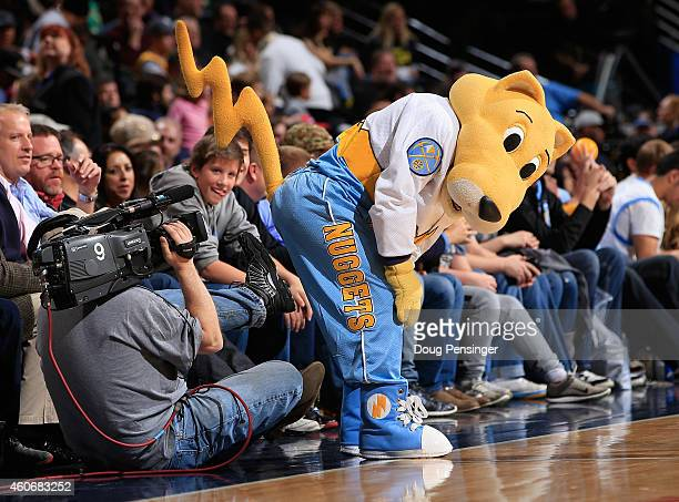 Denver Nuggets super mascot Rocky jokes with a television cameraman as they face the San Antonio Spurs at Pepsi Center on December 14 2014 in Denver...