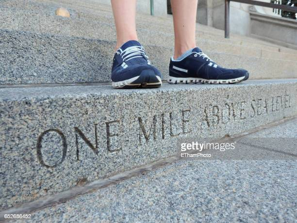 Denver 'one mile above sea level' step on stairway to Colorado State Capitol