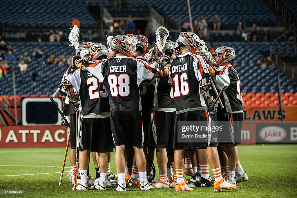 Denver Outlaws celebrate the win over the Charlotte Hounds during a Major League Lacrosse game at Sports Authority Field at Mile High on June 29, 2013 in Denver, Colorado. The Outlaws beat the Hounds 17-11 and improved to 9-0 on the season.