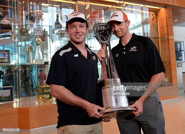 Denver Outlaws Defenseman Matt Bockleta and Assistant general manager Jon Cohen hold up the Steinfield Trophy at Dove Valley The Outlaws defeated...