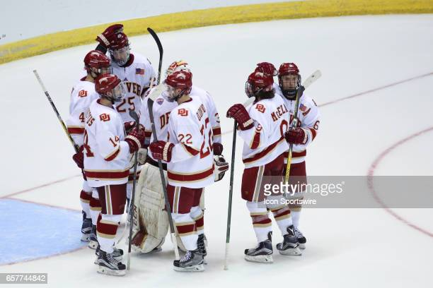 Denver Pioneers celebrate after winning the Midwest Regional of the NCAA Hockey Championship between the Denver Pioneers and the Michigan Tech...