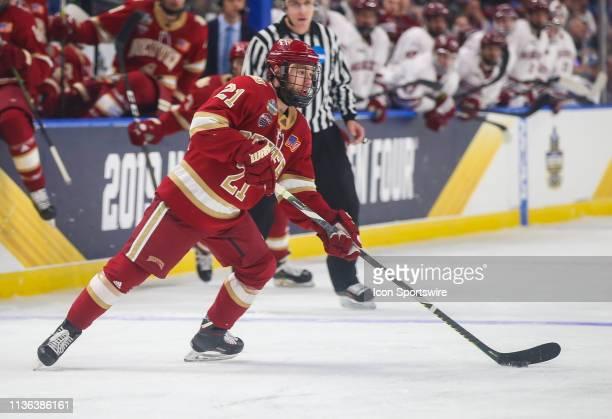 Denver Pioneers Defenseman Michael Davies wood to pass during the NCAA Frozen Four men's hockey game between Massachusetts Minutemen and Denver...