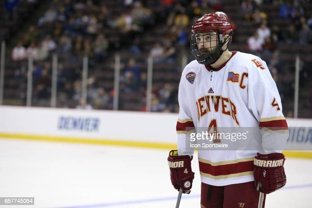 Denver Pioneers defenseman Will Butcher looks on during the Midwest Regional of the NCAA Hockey Championship between the Denver Pioneers and the...