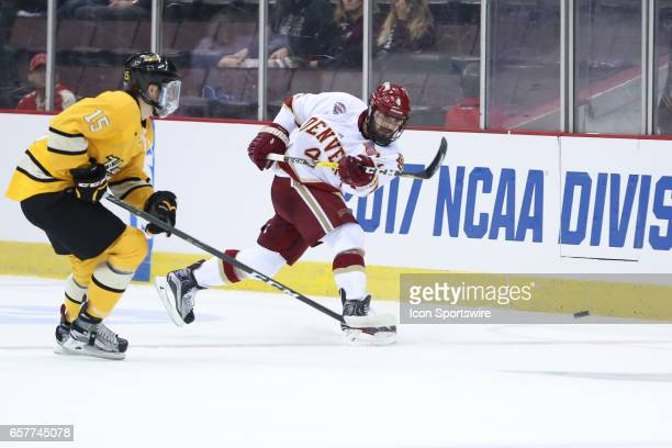 Denver Pioneers defenseman Will Butcher passes the puck during the Midwest Regional of the NCAA Hockey Championship between the Denver Pioneers and...