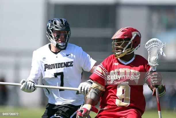 Denver Pioneers faceoff Trevor Baptiste pursued by Providence Friars defender Austin Yezarski during a college lacrosse match between Denver Pioneers...