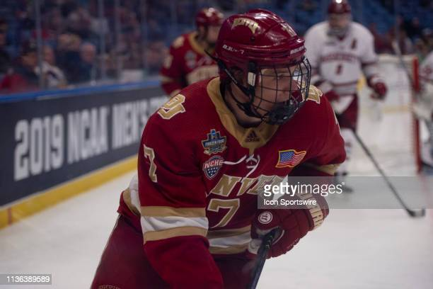 Denver Pioneers Forward Brett Stapley skates with the puck during the overtime period of the game between the Massachusetts Minutemen and the Denver...